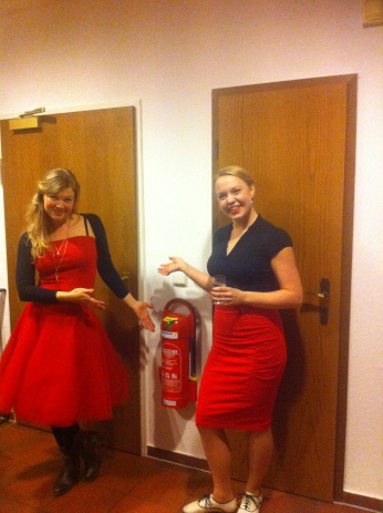 Ladies, and fire extinguisher, in red